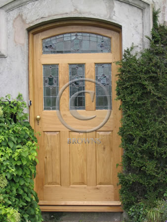 Solid oak panel door with stained glass