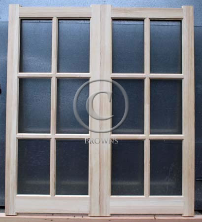 Six pane softwood doors with ovalo mould