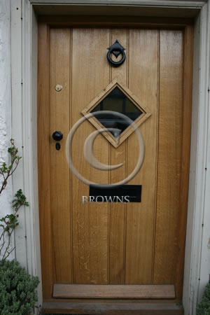 Black ironmongery on an oak door