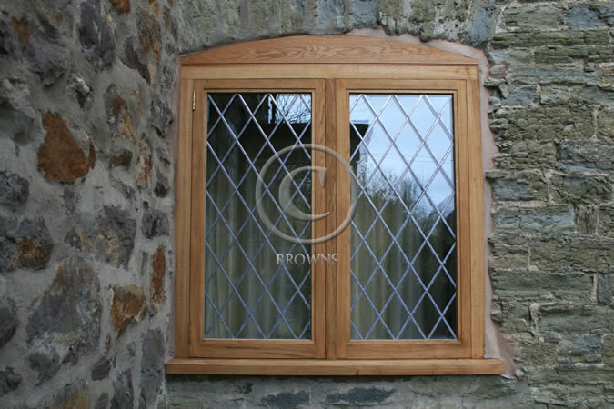 Oak flush windows with arched infills